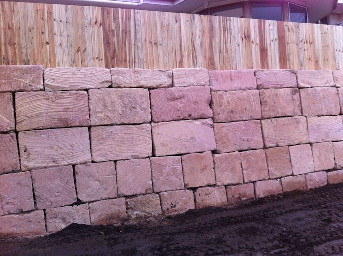 A grade sandstone and paling fence