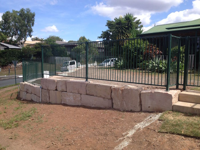 Grade B Sandstone Fence on Incline